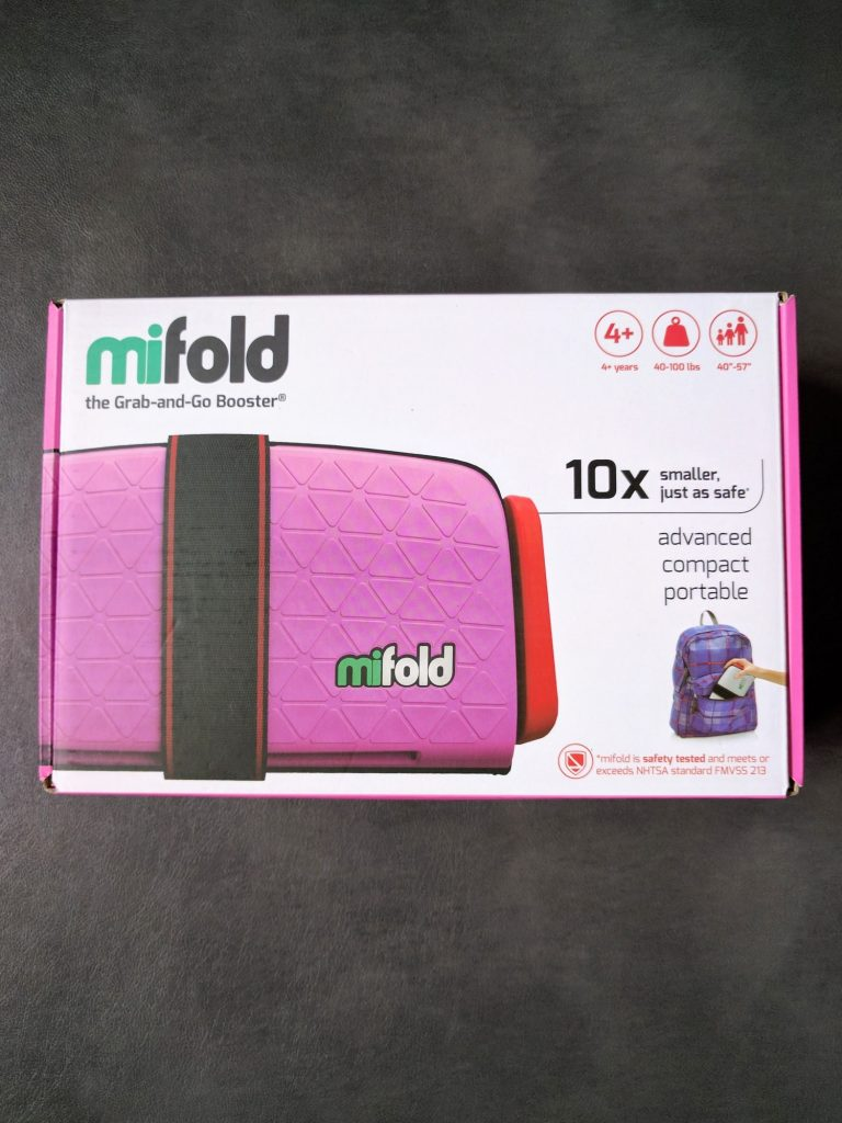 Packing a booster seat for vacation can be frustrating. Find out all about our real life experiences using a MiFold booster seat for travel.