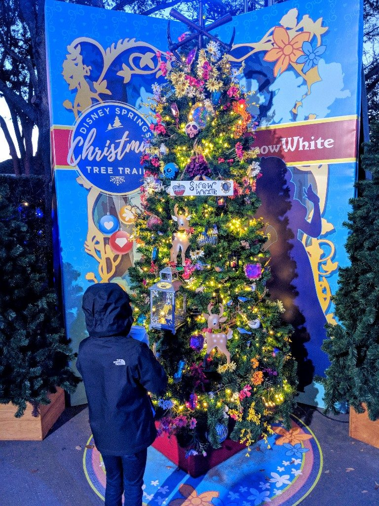 The Disney Springs Christmas Tree Trail at Disney World is a fun and free way to get in the Christmas spirit. Find out more about this seasonal event. #disneysprings #disneyworld #disneychristmas #disney #christmas