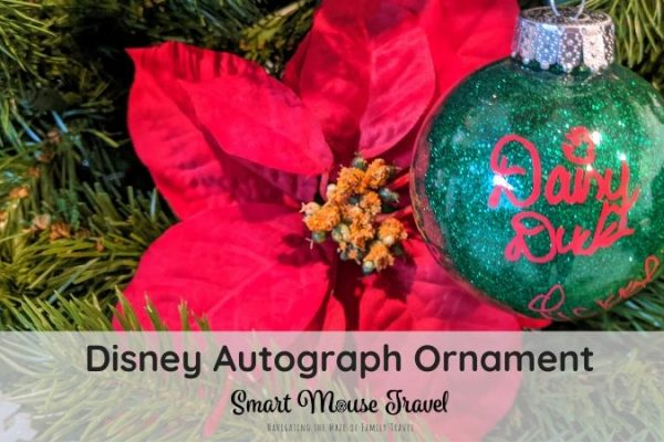 Disney character autographs are a great way to interact with characters. This DIY Disney autograph ornament makes a great souvenir and keepsake. #disneyland #disneyworld #disneycrafts #disneycharacters #disney #christmas