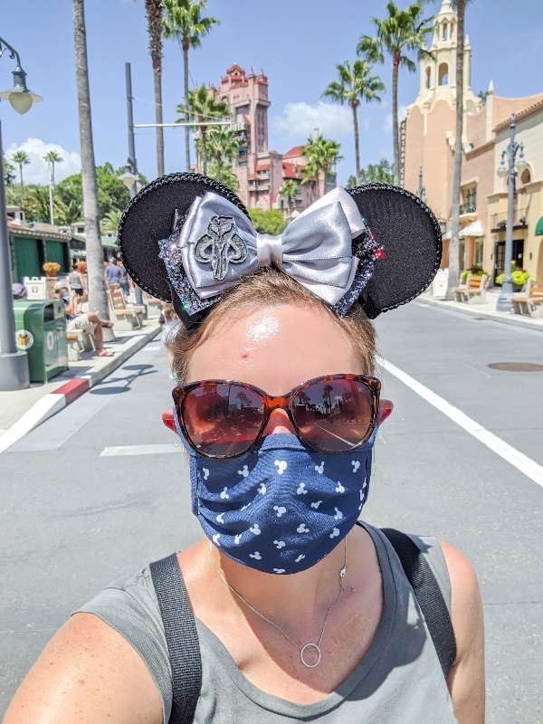 Woman in mask in from on Hollywood Studios Tower of Terror
