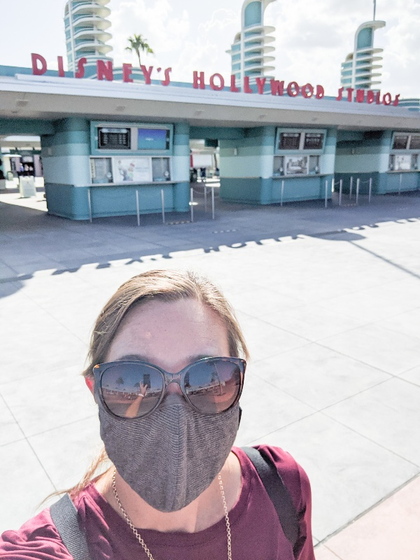 Woman in front of Hollywood Studios in mask