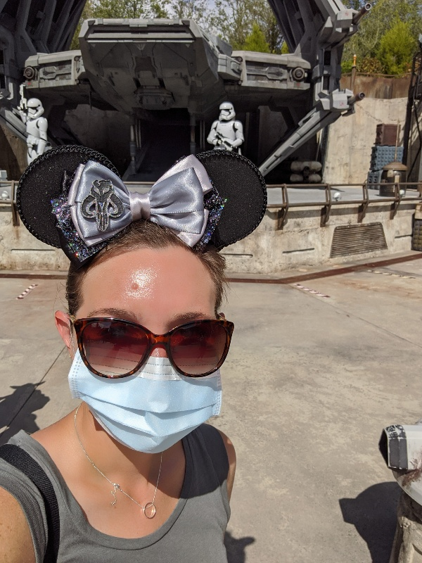 Woman in front of Storm Troopers with mask