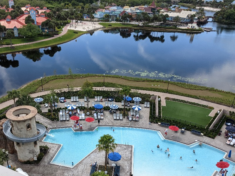 View of Riviera pool and lake beyond. Take a tour of our Disney's Riviera Resort 1 bedroom villa which is a sophisticated take on the usual Disney World resort experience. #disneysrivieraresort #disneyworld