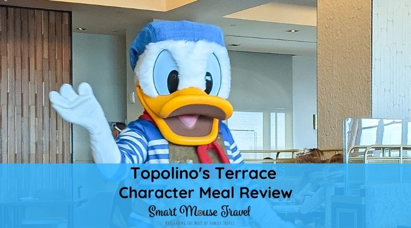 Donald Duck waves to guests. Topolino's Terrace Breakfast à la Art with Mickey & Friends is a good way to see classic characters with a delicious meal at Disney World.