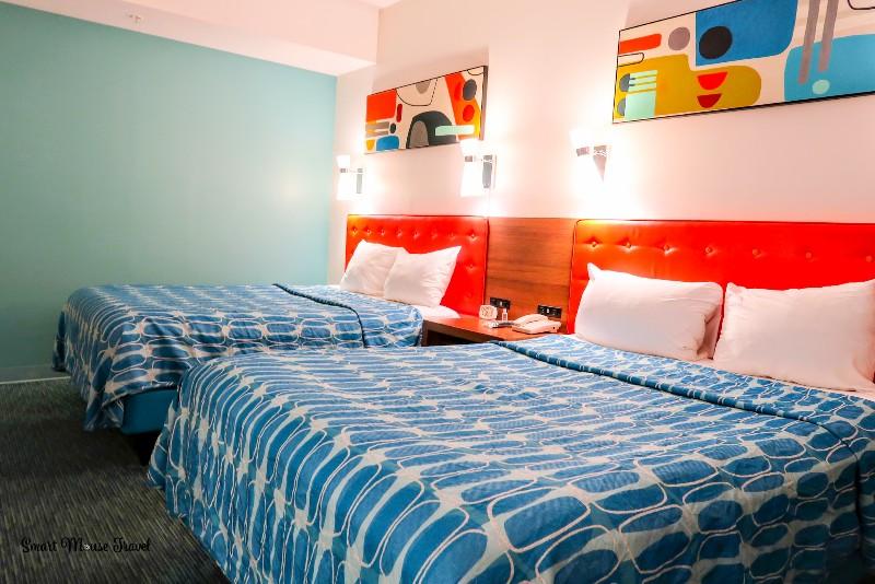 Cabana Bay Beach Resort family suite beds with orange headboards and retro art.