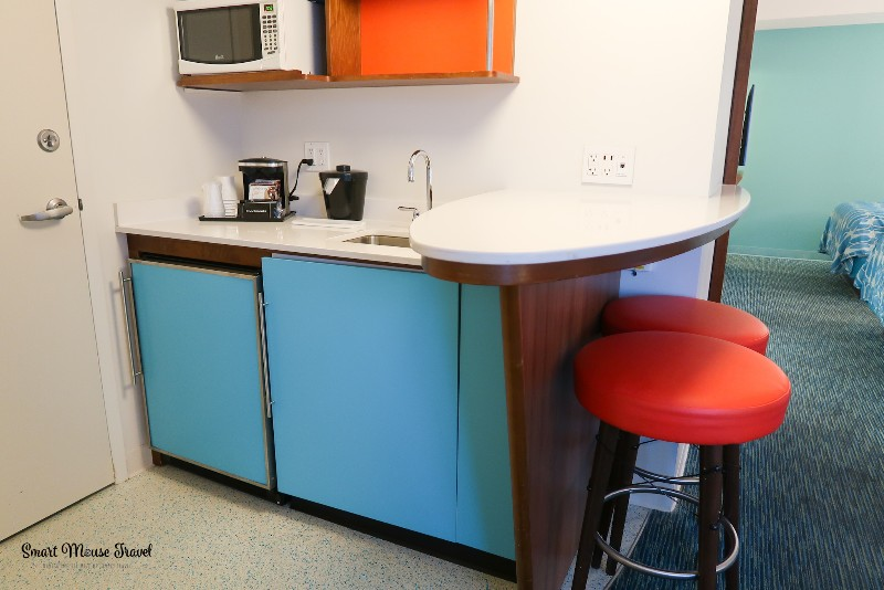 Cabana Bay Beach Resort Family Suite kitchenette with mini fridge and microwave.
