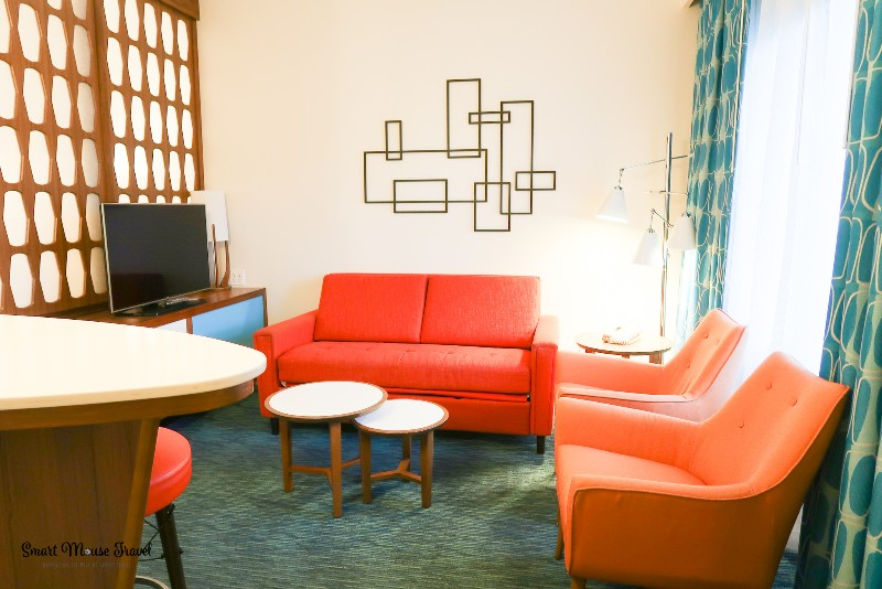 Cabana Bay Beach Resort Family Suite living room with fold out couch and two side chairs.