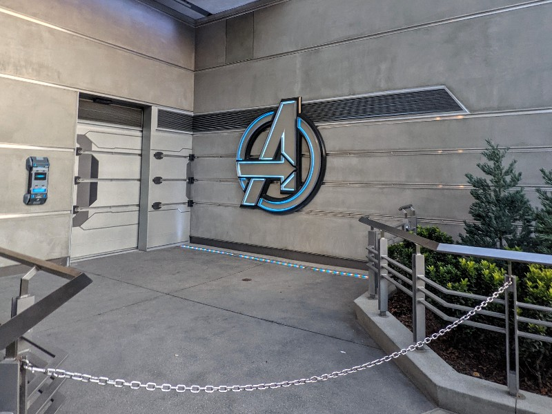 Avengers logo on side of Avengers Campus building.