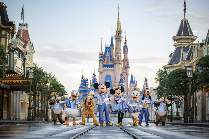 Disney characters in new EAridescent costumes in front of Cinderella's Castle on Main Street