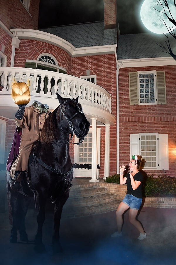 Woman recoils in horror from pretend headless horseman Magic Shot at Disney After Hours Boo Bash