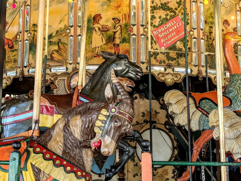 Old fashioned carousel with original wooden animals is perfect when visiting Balboa Park with kids