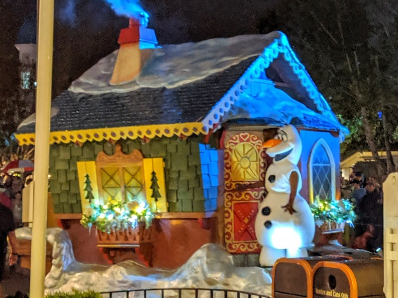 Olaf stands on a float during Mickey's Once Upon a Christmastime Parade