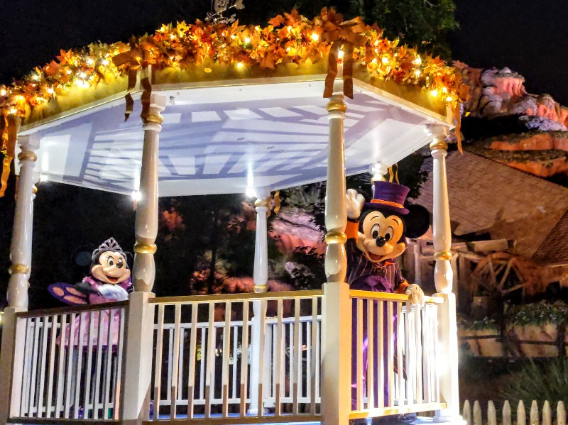 Mickey and Minnie dressed in Halloween costumes during Disney After Hours Boo Bash