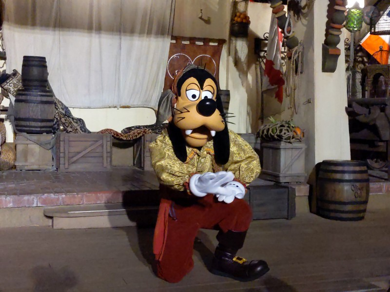 Pirate Goofy kneels down to take a picture during Disney After Hours Boo Bash at Magic Kingdom.