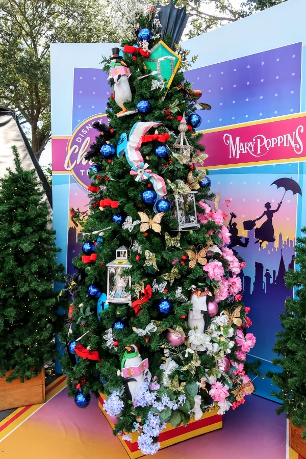 A Mary Poppins inspired Christmas tree with suffragette sash, penguins, and Mary's umbrella at Disney Springs