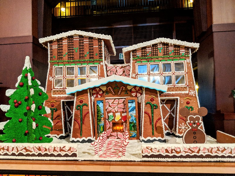 A giant gingerbread house is a signature part of Disney's Grand Californian Christmas decor.