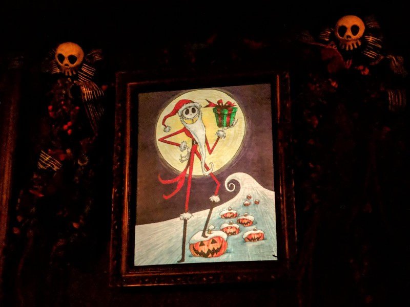 Jack Skellington dressed as Santa Claus in a portrait in the Haunted Mansion Holiday