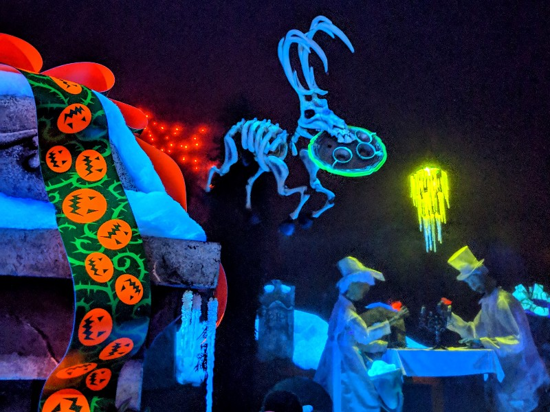 A skeleton reindeer floats above the cemetery during Haunted Mansion Holiday overlay