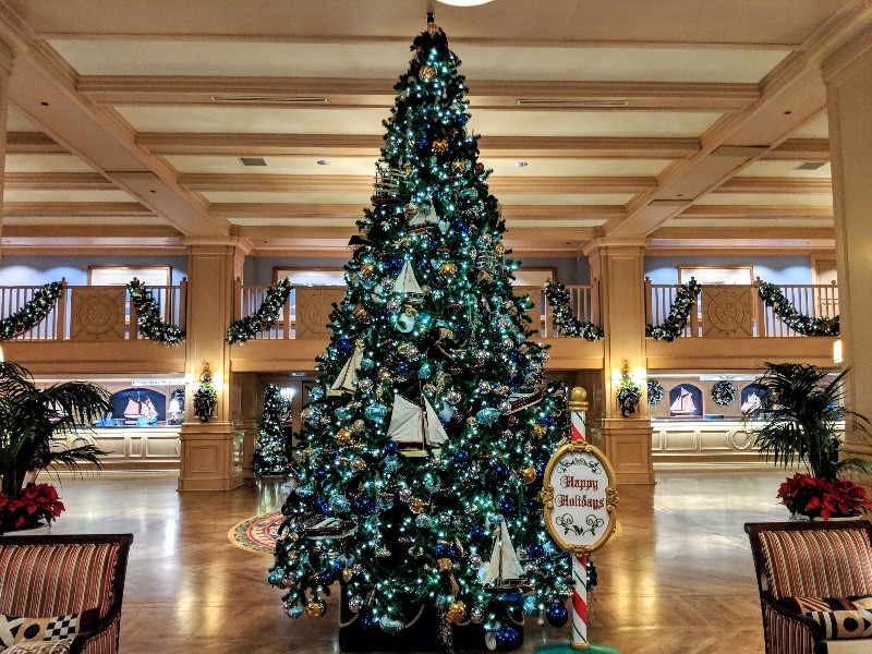 A nautical themed Christmas tree in blues and greens welcomes guests at Yacht Club