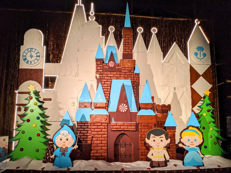 """A giant gingerbread facade of Cinderella Castle with hints of """"it's a small world"""" make a stop at Disney's Contemporary Resort seasonal fun"""