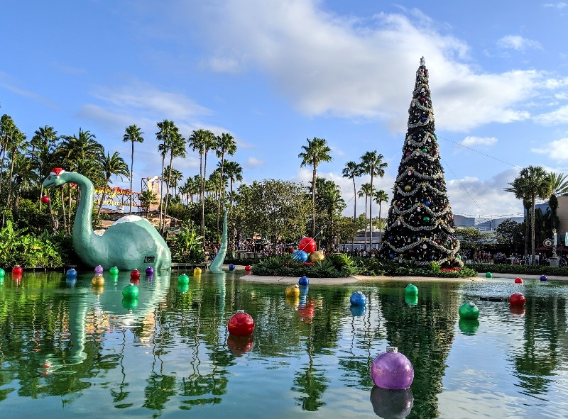 Echo Lake at Disney's Hollywood Studios with a giant Christmas tree and Gertie the Dinosaur in a Santa hat