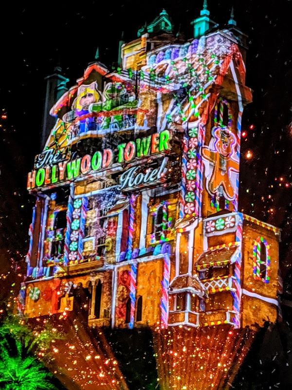 Tower of Terror with colorful festive projections that make it seem like a gingerbread house