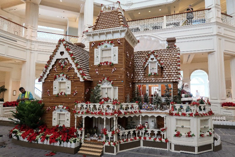 A fully decorated two story gingerbread house at Disney's Grand Floridian looks and smells wonderful during Disney World Christmastime