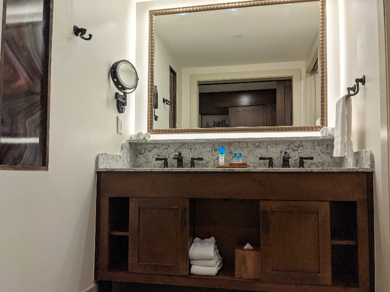 Double sinks below a large mirror at Disney's Wilderness Lodge