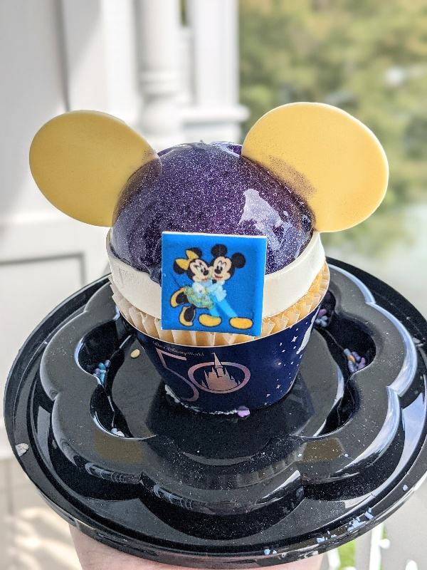 EARidescent Cupcake from Gasparilla Grill at Grand Floridian sparkles in the sunlight